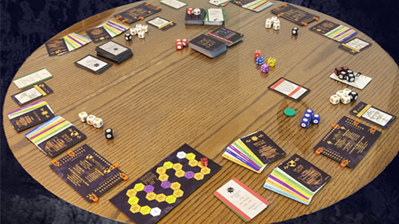 A collaborative, role-playing, card & dice tabletop game.