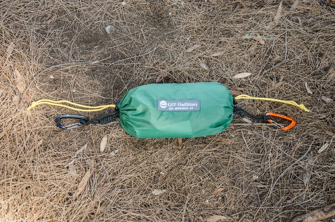 """The Rapid Deployment Bag has an opening at each end. You can use the different colored carabiners to mark the """"head end"""" of the hammock that you prefer"""