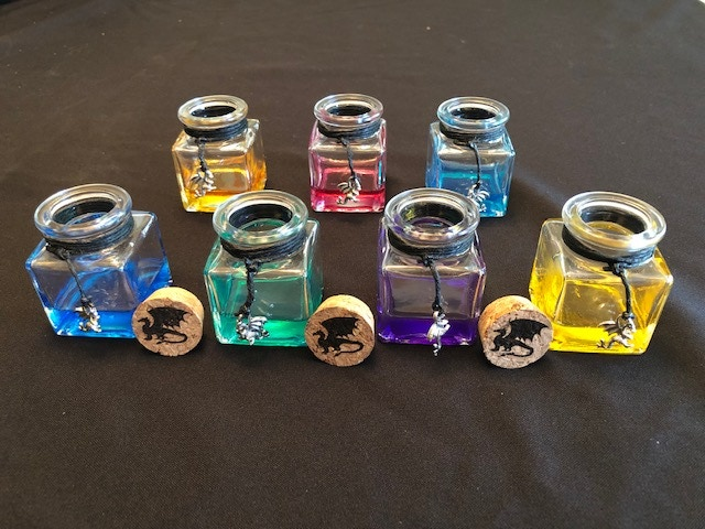 Front left to right: Blue, Green, Purple, Yellow  Back left to right: Orange, Magenta, Teal
