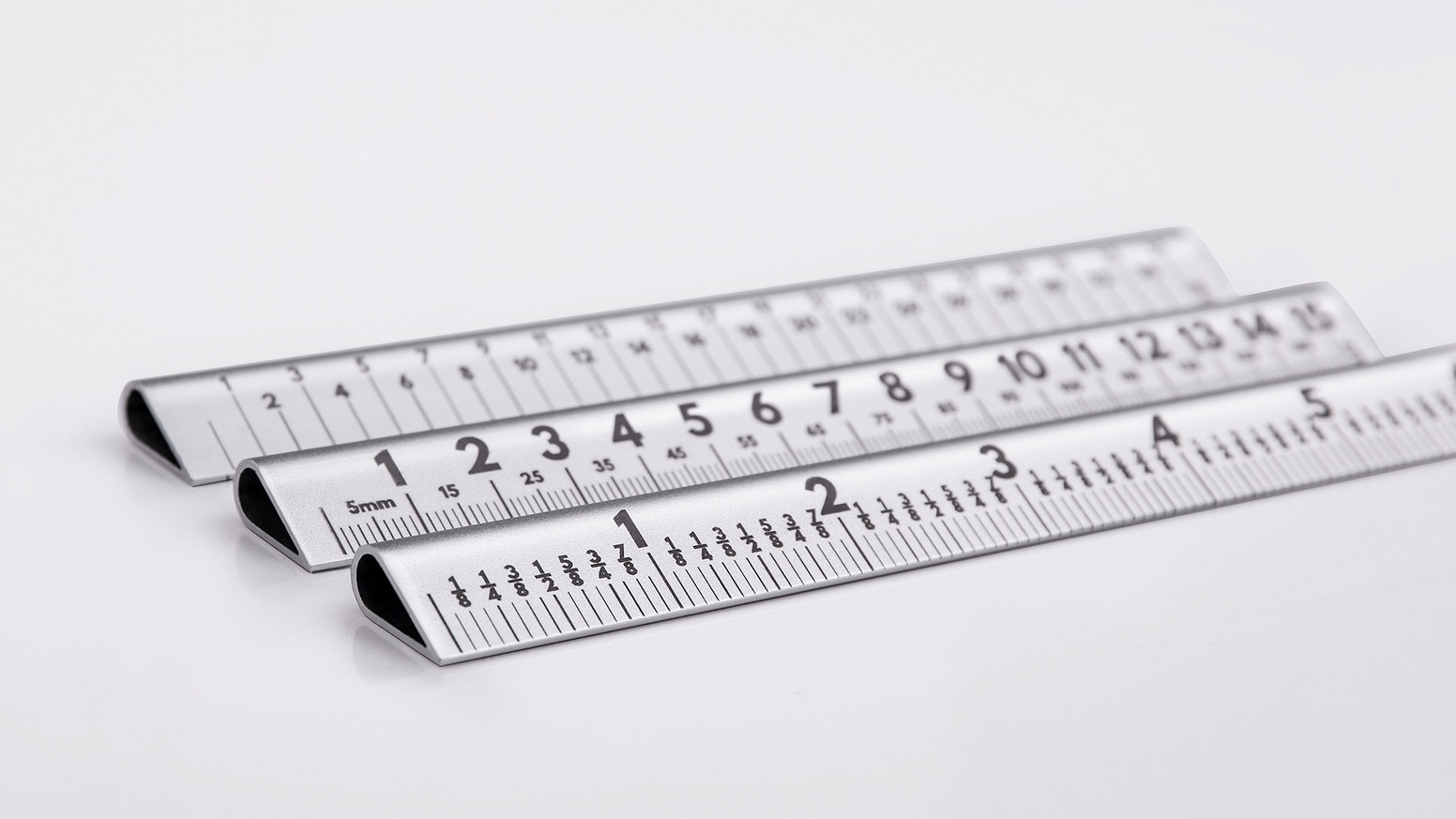 A laser engraved, aerospace aluminium ruler set at a practical 30° angle... designed for designers, suitable for everyone.