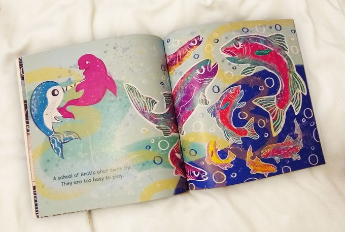 Little Narwhal and Little Beluga find a school of Arctic char in a paperback proof