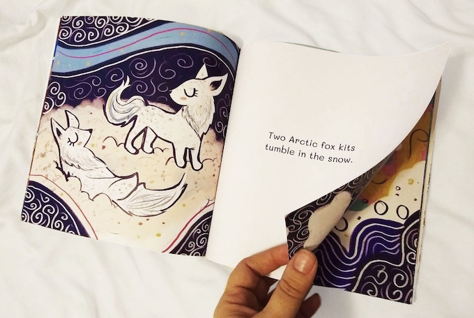 Arctic foxes play in this proof copy of Little Narwhal's Day