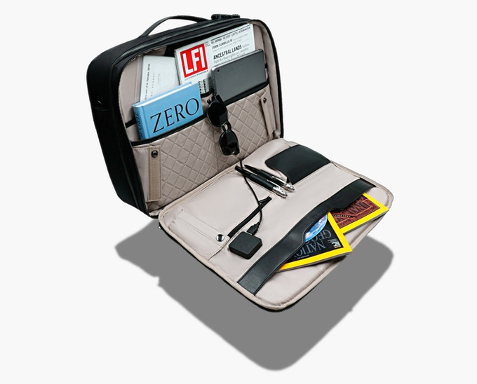 Multi-compartment interior with two quilted pockets to compartmentalize your electronics.