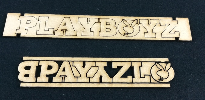 unpainted sample, it's made in 2 layers, the base and the 3D letters and symbol