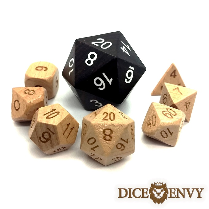 33 mm Chonky Boi in ebony next to a standard size set of wooden dice.