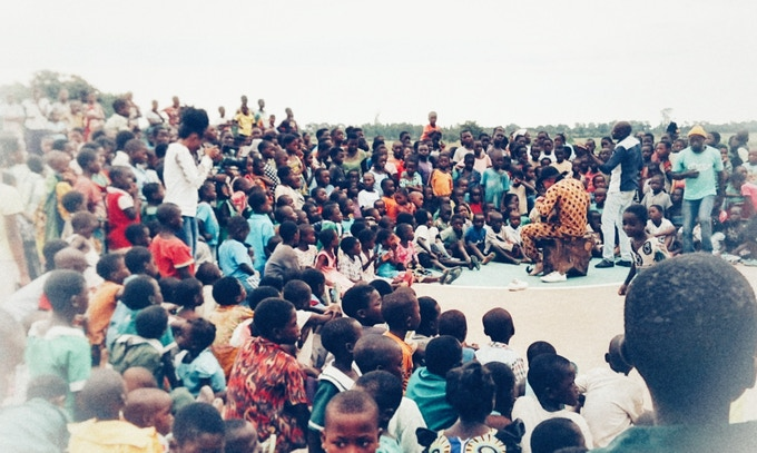Lazarus playing a show at a school in Lilongwe, raising awareness about the persecution of people with albinism.