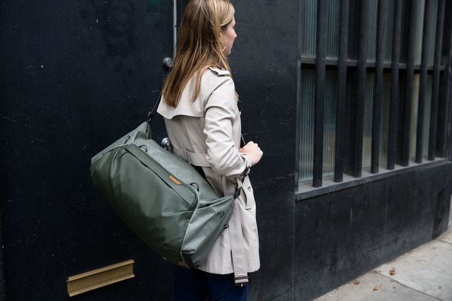 A golden sample of the Travel Duffel 35L in sage, modeled by Heidi, our general counsel.