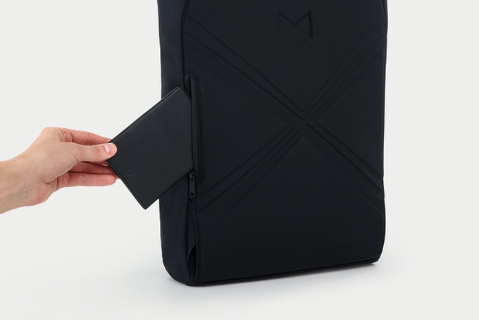 The RFID Travel Wallet fits inside the Rolltop's secret pocket and all its other pockets.