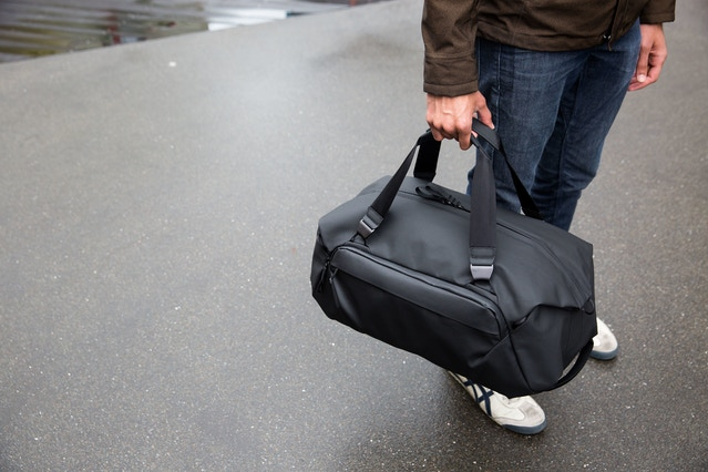 The Duffel 35L features 2 hand straps, each with hypalon/leather handles and custom aluminum quick connecting hardware.