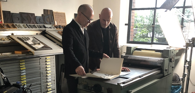 "Publisher Markus Sebastian Braun and designer Erik Spiekermann with the ""Guidelines and Standards for the Visual Design"" at letterpress studio p98a.berlin"