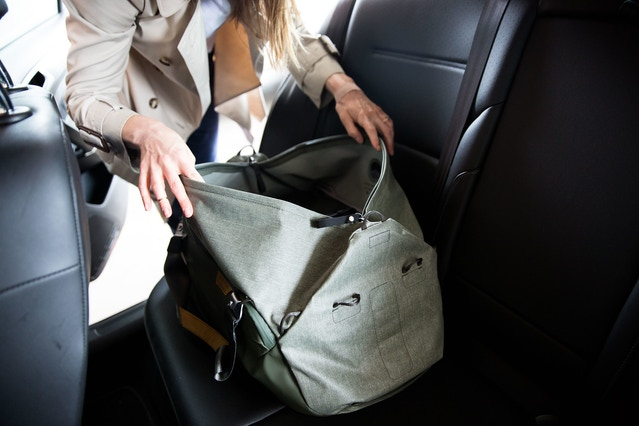 To achieve easier access and visibility, the zipper path actually extends beyond the main compartment of the bag, creating short wings at each end. When in hand-carry configuration, these wings remain cleanly attached to the ends of the bag via magnetic clasps. When in shoulder carry mode, the wings serve as an aesthetic and reinforced strap connection point.