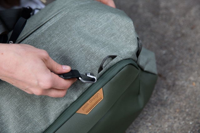 One more close-up of the Cord Hook hardware. The Cord Hook easily snaps onto one of many Cord Loops located on the exterior of the bag, allowing you to quickly reconfigure carry straps. This simple, strong strap connection system was first used with the external carry straps on the Travel Backpack 45L and we plan to use it on many more bags in the future.