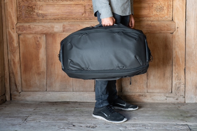 Carry the Duffelpack 65L via side handles...
