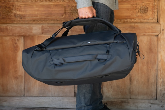 ...or carry via padded tubular webbing carry handles located on the stowable shoulder straps.