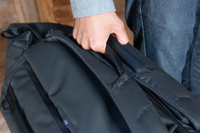 A closer look at the Duffelpack's carry handles located on the shoulder straps. Also note the ID card slot on the back panel.
