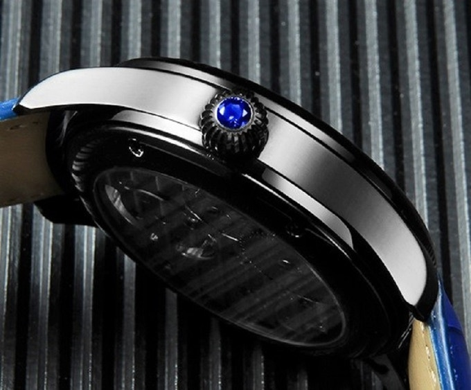 Semi-precious Zircon stone embedded into the winder and Sapphire glass back.