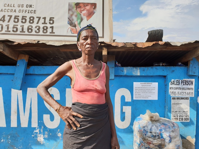 Waste picker Madam Yaa Sule stands in front of collected waste satchets. Fibi Adikour Afloe, Ghana