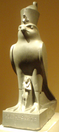 Nectanebo under the protection of the god Horus.