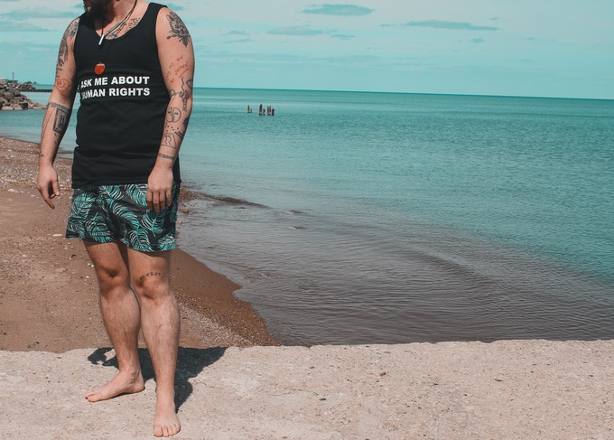 """Basil (@TiniestKing) modeling our """"Ask me about human rights"""" tank top"""