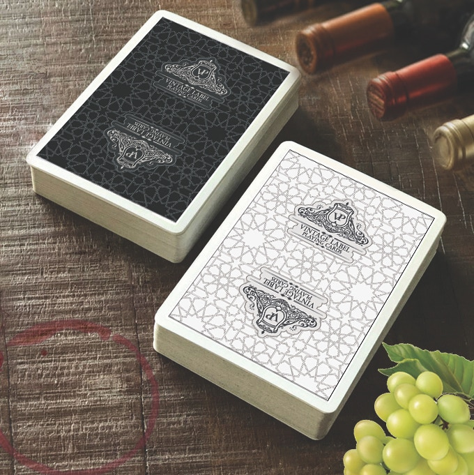 Visualisation of a Premier Edition Black Deck (Available in this Kickstarter) and a Premier Edition White Deck (Coming soon to Kickstarter) with our Premium 310gsm Linen Card Stock with added air pockets, for superior performance and handling.