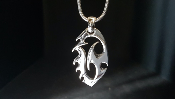 Exélixi 925 sterling silver pendant meaning 'evolution'