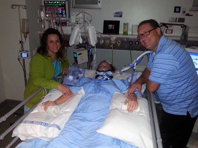 Kendal and her parents in the hospital while she was in a coma.