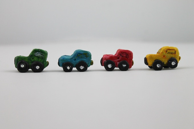 4x Mini Jeep like game pieces. (Red, Yellow, Blue & Green)