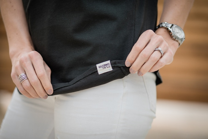 "Each shirt comes with this ""It's All Connected"" tag that faces the inside. The words are not visible when it's being worn."