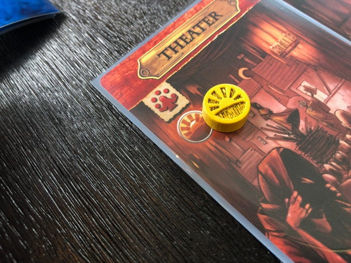 One of the 35 wooden Hope tokens in deluxe, basking in the light of the Puritans