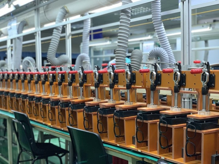 An army of clamping fixtures on the production line