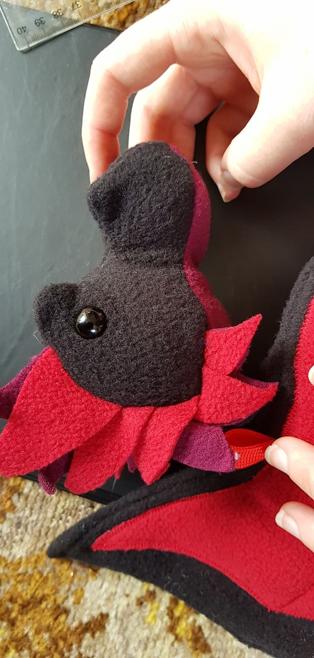 Black and Red Dragon Bagon sample, head side on view