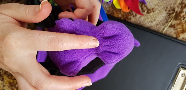 Slightly deflated nose of a Purple and Teal Dragon Bagon sample. See the more obvious wrinkles in the fabric?