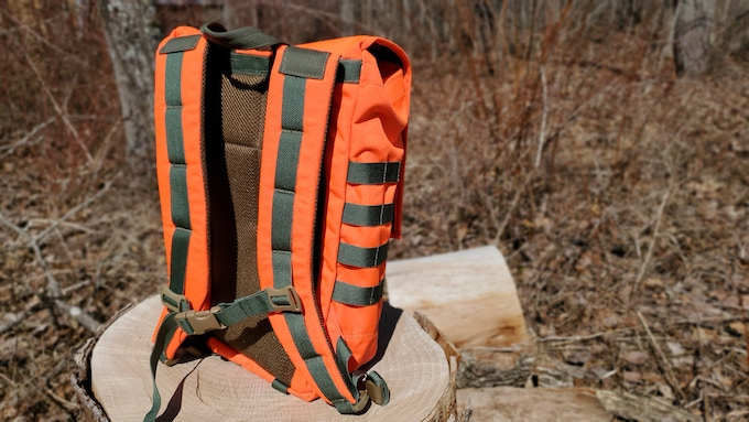 ENDLESS POSSIBILITIES ADVENTURE PACK Limited Signature addition Day Ruck Hidden Woodsman Pack It looks super bright but it is actually more of a pumpkin orange.