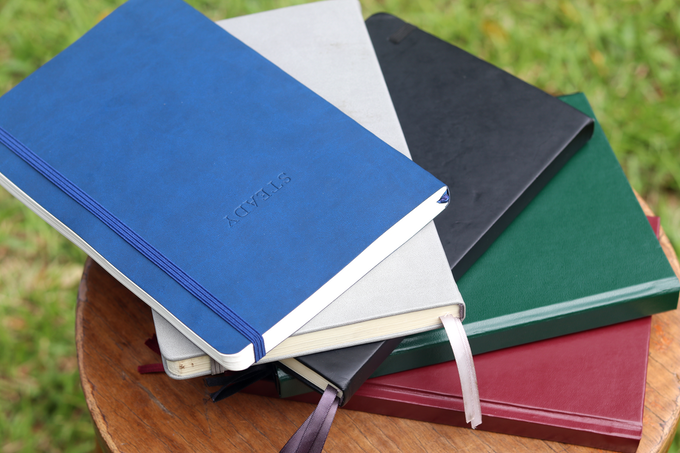 The Steady Planner in all 4 colours: Blue, black, grey, burgundy