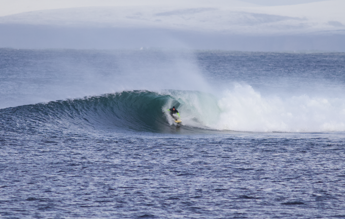 Mark Boyd sits inside another North Coast wave - note the snow on the mountains in the background!