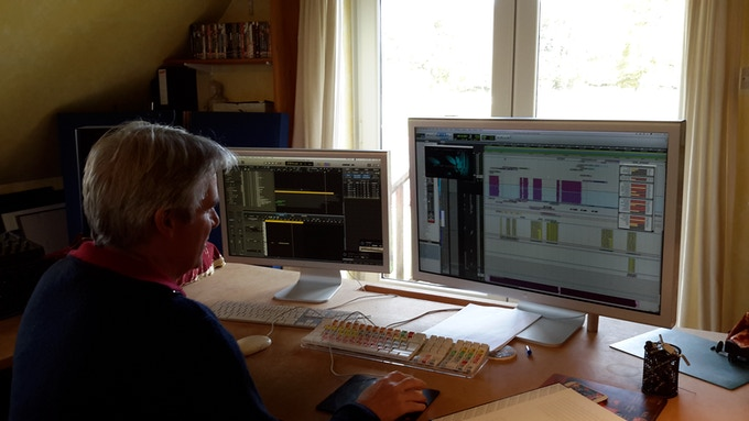 Richard Wells in his studio working on original FOE score.
