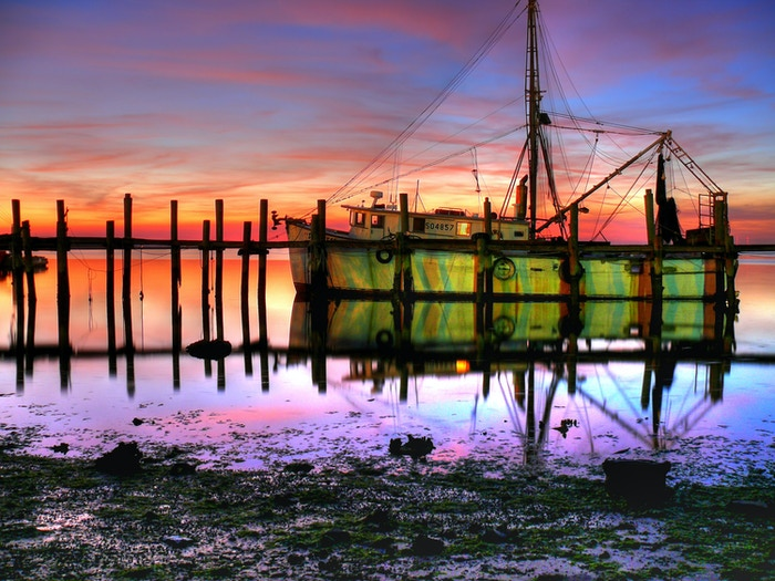 Images of the rapidly disappearing hand crafted wooden Shrimp Trawlers of the South shared through a book, gallery exhibits and prints