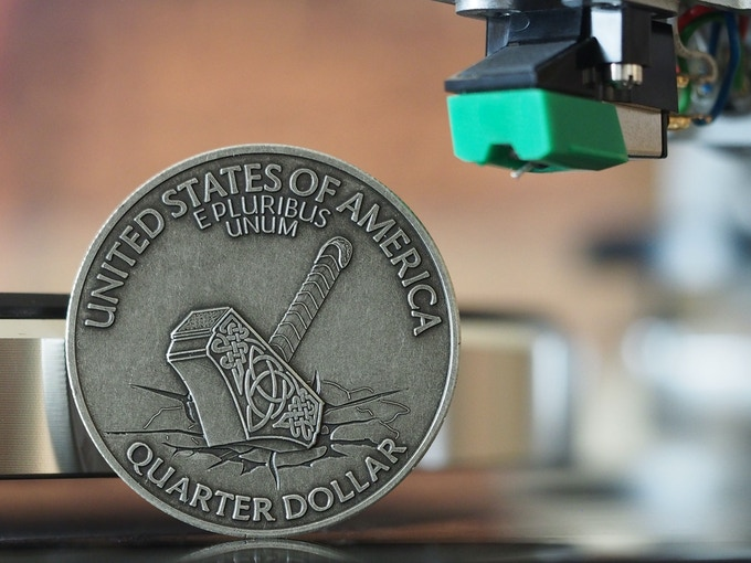 The Hammer of the Gods, back, based on the 1970 Quarter Dollar. Shown here in Antique Silver. Please note that all images are comps and the actual coins may vary slightly.
