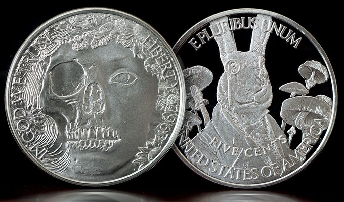 Solid Silver White Rabbit - One Troy Ounce of solid .999 pure silver. Will be shipped to you with a numbered authenticity card and will be delivered in a lucite capsule enclosure.