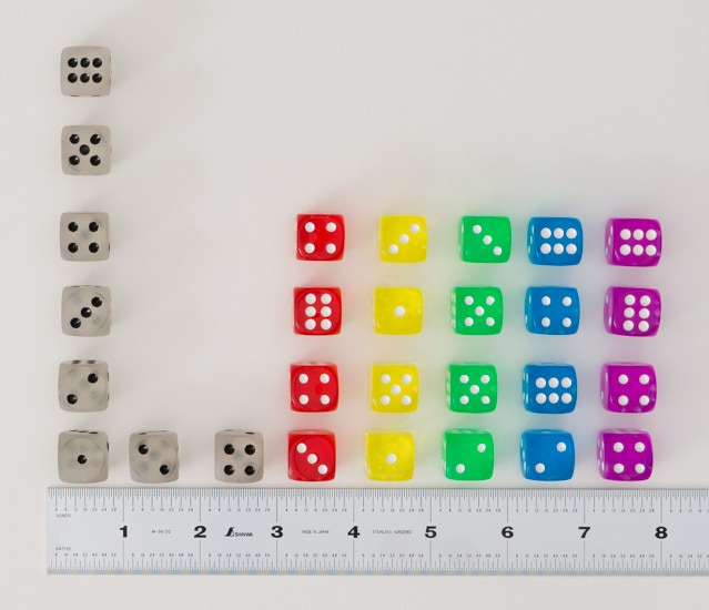 PPC Dice on light background, blasted with light