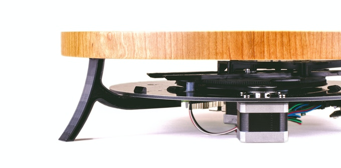 The Mini ES has open sides, revealing the Sisbot as it works to move the ball