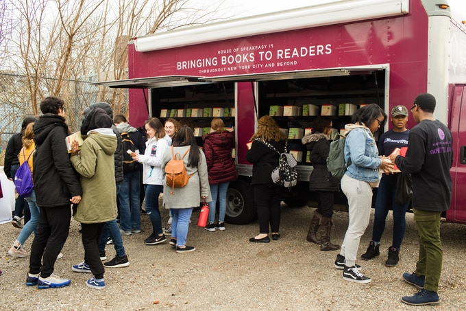 Teenagers at a N4 story exchange in the Bronx pick up books from the House of SpeakEasy book truck.