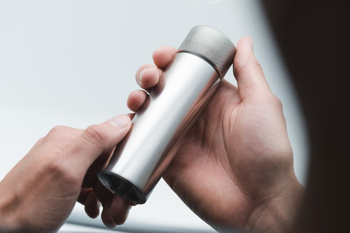 A 100ml / 3.4 fl.oz. cylindrical stainless steel flask. Designed in London. Machined in the UK. Personalised with your inscription.