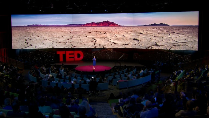 Nora Atkinson using my photo in her TED talk about Burning Man