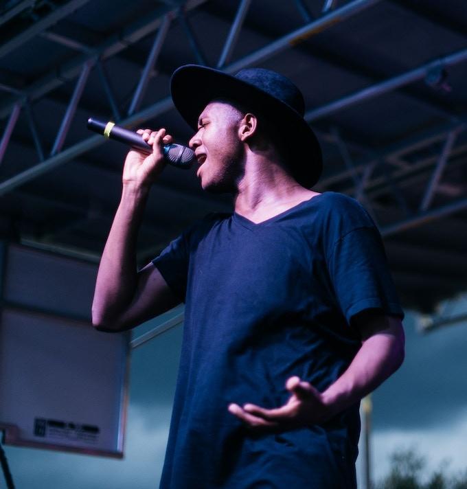 Justin Oliver singing at outside show