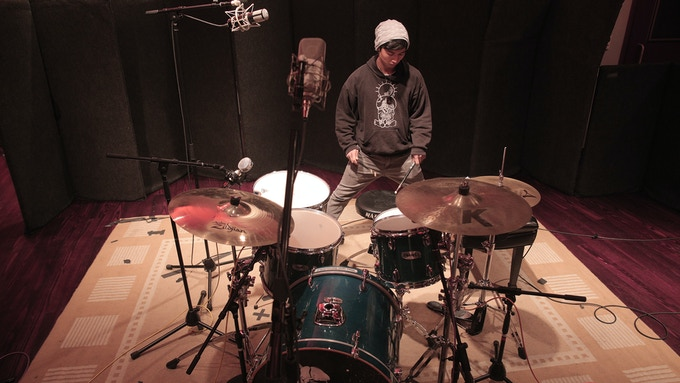 Mogli in the studio recording drums for Lake of Dreams