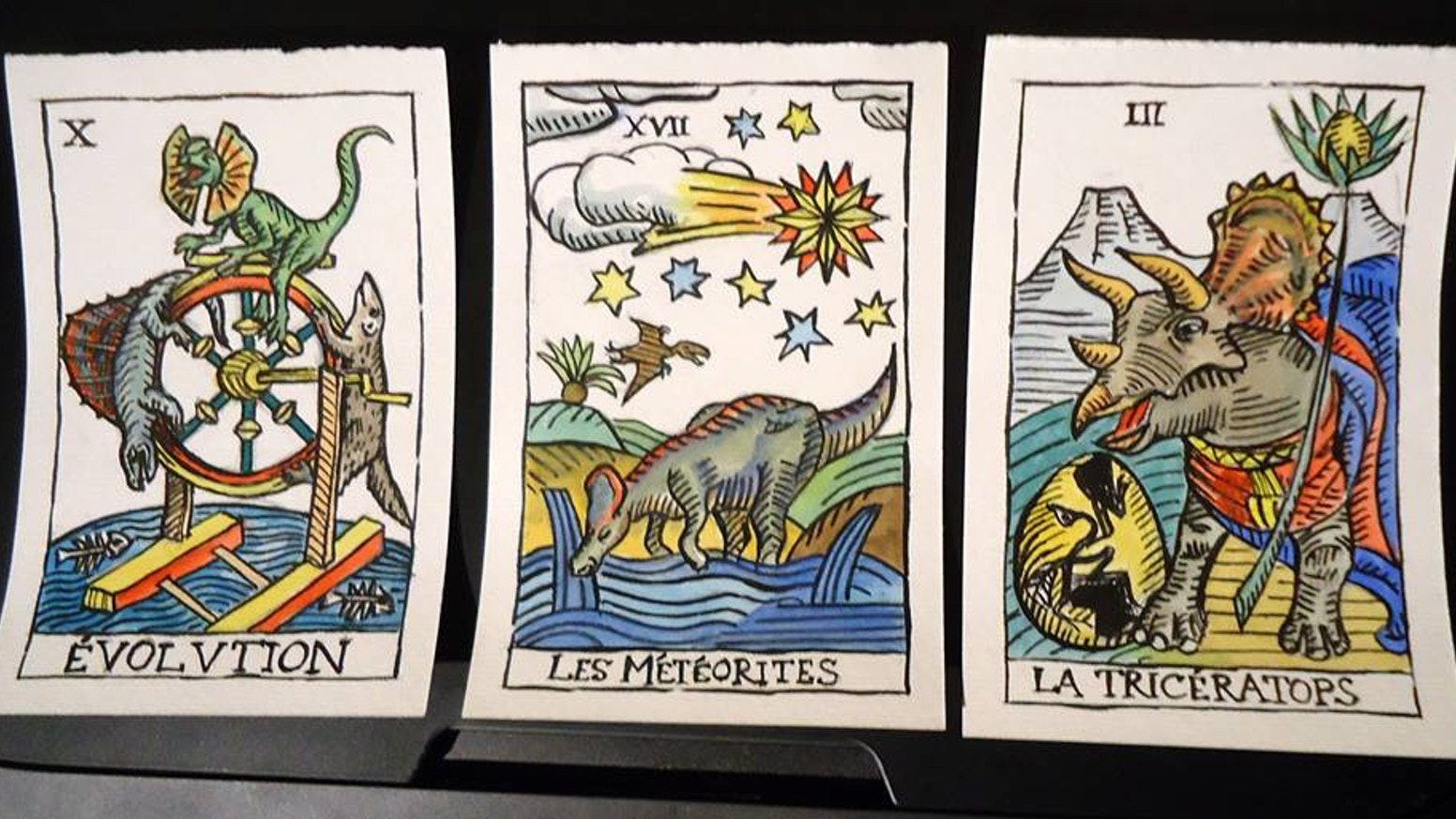 Dinosaur themed tarot deck in a classic Marseille style.