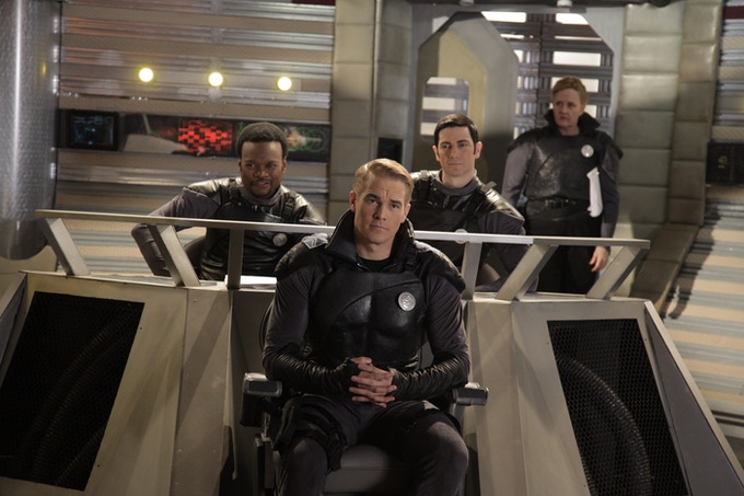 Captain Jack Kemmer and his crew on the bridge of the Paladin