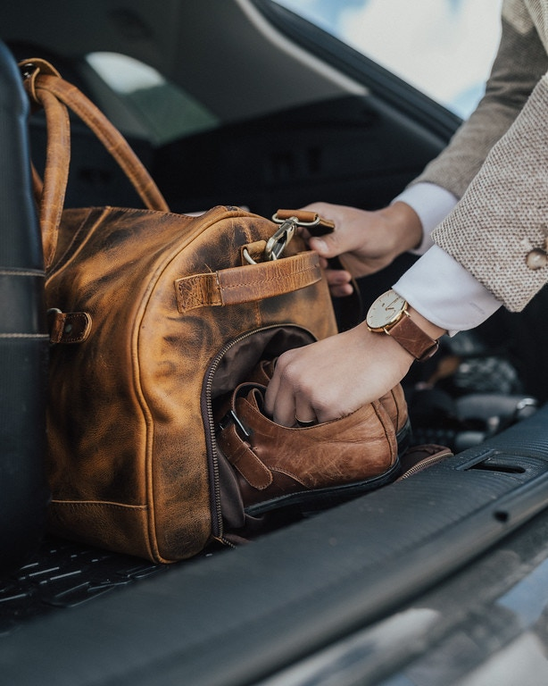 Convenient and secure exterior shoe pocket