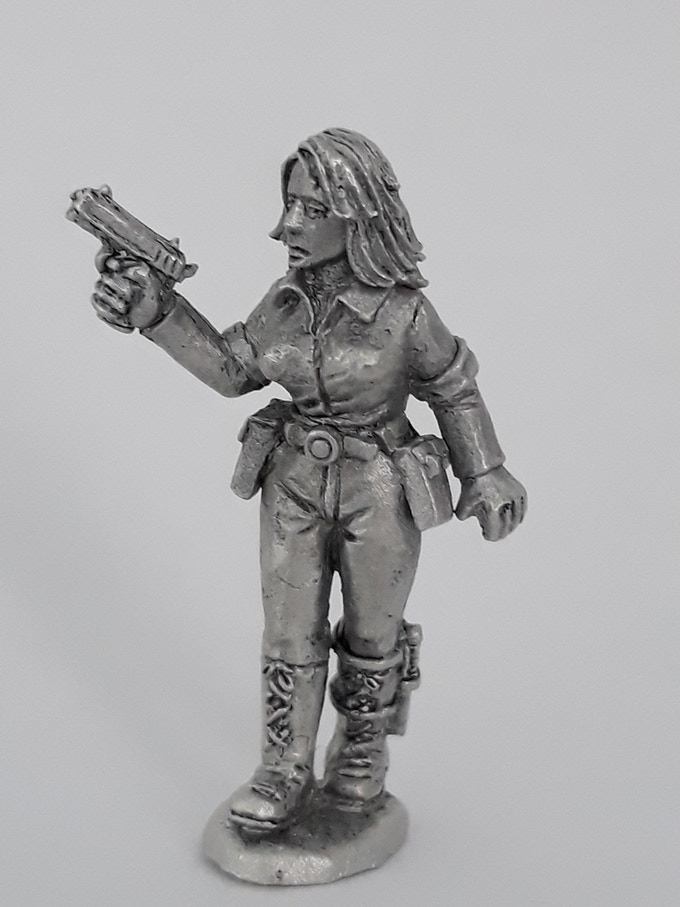 Female survivor front view. A survival knife is strapped to her boot, she aint to be messed with this one